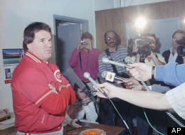 Cincinnati Reds manager Pete Rose talks with reporters following the Cardinals Reds baseball game in St. Louis Sunday, May 14, 1989. The Reds manager, suspected of gambling talked with reporters after every game during a news conference, but only discussed the game and baseball in general. (AP Photo/Al Behrman)