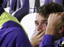 A smarting Adem Ljajic watches on from the bench after Delio Rossi attacked him