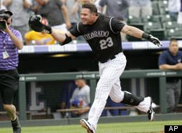 Colorado Rockies pinch hitter Jason Giambi (23) heads for home after hitting a walk-off home run off Los Angeles Dodgers relief pitcher Scott Elbert during the ninth inning of a baseball game, Wednesday, May 2, 2012, in Denver. The Rockies won 8-5. (AP Photo/Barry Gutierrez)