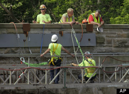 Workmen repair on old stone bridge over the Rocky River in North Olmsted, Ohio, Thursday, June 9, 2011. (AP Photo/Mark Duncan)