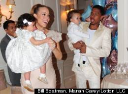 Mariah Carey and Nick Cannon carry twins Monroe and Moroccan in Paris. Credit: Bill Boatman, Mariah Carey / Lotion LLC