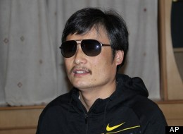 In this photo taken in late April, 2012, and released by Zeng Jinyan, blind Chinese legal activist Chen Guangcheng is seen at an undisclosed location in Beijing during a meeting with human rights activists Hu Jia and Zeng Jinyan.  (AP Photo/Zeng Jinyan)