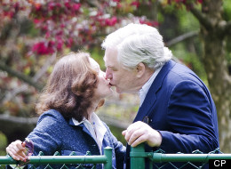 Conrad Black and his wife Barbara Amiel kiss shortly after Black arrived in his Toronto home after being released from jail.