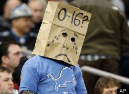 A fan wears a paper bag on his head during the Detroit Lions-New Orleans Saints NFL football game in Detroit, Sunday, Dec. 21, 2008.