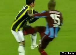 Trabzonspor's Didier Zokora hits Fenerbahce's Emre Belozoglu in response to an alleged racial slur.