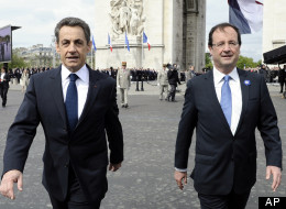 Outgoing French President Nicolas Sarkozy, left, with President-elect Francois Hollande, walk by the Arc de Triomphe in Paris, Tuesday, May 8, 2012, in Paris, during a ceremony marking the end of the anniversary of World War II in Europe.  (AP Photo/Lionel Bonaventure, Pool)