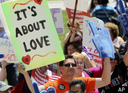 Todd Plank of Rochester, N.Y., holds a sign during a marriage equality rally in Albany, N.Y., on Tuesday, June 21, 2011.
