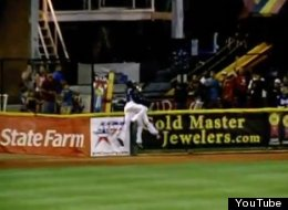 Corpus Christi outfielder, Austin Wates, makes an incredible over-the-wall catch while colliding with teammate Brandon Barnes.