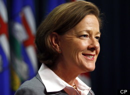 Alberta Premier Alison Redford trimmed her cabinet Tuesday, rewarded some veterans and promoted a controversial rookie to the critical post of energy minister. (CP)