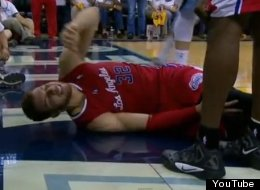 Blake Griffin is booed as he clutches his knee after suffering an injury in Game 5 against the Memphis Grizzlies.