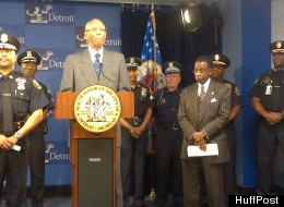 Mayor Dave Bing stands with Detroit's newly appointed chief financial officer, Jack Martin (right), during a press briefing in Detroit on Thursday May 10, 2012.