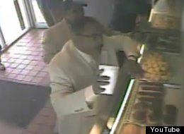 This surveillance video shows a man throwing hot coffee at a donut shop employee after a dispute over payment. The victim suffered severe burns.