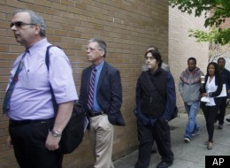 In this April 24 photo, job seekers wait in line during a job fair, in Portland, Ore.