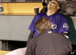 Colorado Rockies shortstop Troy Tulowitzki is tended to by a trainer after being hit by a foul ball hit by Rockies' Dexter Fowler during the eighth inning of a baseball game against the San Francisco Giants in San Francisco, Monday, May 14, 2012. (AP Photo/Jeff Chiu)
