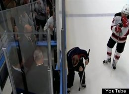 New Jersey's Travis Zajac waits as an MSG employee fixes the penalty box door.