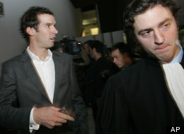 British cyclist David Millar, left, as he arrives with an unidentified lawyer at the Nanterre courthouse. Millar and nine others, including six current or former Cofidis riders, went on trial for their alleged role in a doping scandal.