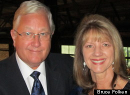 Bruce Folken, pictured with his wife Deb, says a hospital employee asked for money while he was ill in an emergency room bed. Aggressive debt collection stems from larger failings of the U.S. health care system.