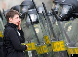 Woman crying in front of a wall of Surete du Quebec riot squad police officers as they advance to remove striking students at the College Lionel-Groulx.The Canadian Press Images-Mario Beauregard