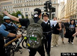 Demonstrators with Occupy Chicago argue with Chicago Police officers as they march through the streets in Chicago, Illinois, May 18, 2012 ahead of the NATO 2012 Summit. (JIM WATSON/AFP/GettyImages)