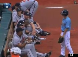 Braves reliever Livan Hernandez welcomes a Tampa Bay Rays ballboy to the majors with a shower of sunflower seeds after witnessing him miss a ground ball.