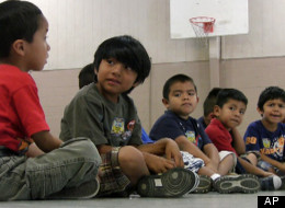Students sit in the gym at Crossville Elmentary School in Crossville, Ala., Aug. 17, 2011. Despite being in an almost all-white town, the school's enrollment is about 65 percent Hispanic.
