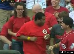 Reds fan Caleb Lloyd caught two home run balls in a game against the Braves.