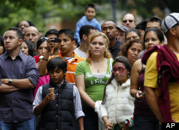 In this photo taken Sunday Sept. 18, 2011, people watch a musical performance at the Fiesta del Pueblo festival in Raleigh, N.C.