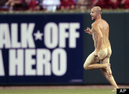 A man runs on the field before the start of the seventh inning of a baseball game between the St. Louis Cardinals and the Philadelphia Phillies Thursday, May 24, 2012, in St. Louis. (AP Photo/Jeff Roberson)