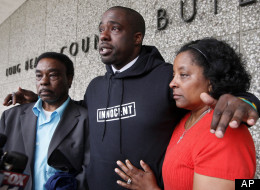 Brian Banks, center, reacts with his mother, Leomia Myers and father, Jonathan Banks, outside court after his rape conviction was dismissed Thursday May 24, 2012 in Long Beach, Calif. (Associated Press)