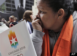 In this Oct. 2, 20099 file photo, a Chicago 2016 supporter reacts after Chicago was eliminated on the first vote in its bid to host 2016 Summer Olympic Games during an announcement ceremony at Daley Plaza in Chicago. (AP Photo/M. Spencer Green, File)