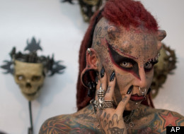 Maria Jose Cristerna poses for pictures during a press conference at a tattoo shop in Bogota, Colombia, Friday, June 3, 2011. (AP Photo/William Fernando Martinez)