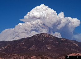In this May 22, 2012 file photo provided by David Thornburg, a plume of smoke rises from the Whitewater fire burning in the Gila Wilderness east of Glenwood, N.M. (AP Photo/David Thornburg, File)