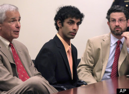 Dharun Ravi sits between his attorneys, Joseph Benedict, left, and Philip Nettl, right, during a hearing in New Brunswick, N.J., Wednesday, May 30, 2012. Ravi, a former Rutgers University student who used a webcam to watch his roommate kiss another man days before the roommate killed himself was sentenced May 21, 2012, to 30 days in jail and three years of probation. After apologizing for the first time Tuesday, May 29, Ravi gave up his right to remain free on Wednesday while New Jersey prosecut