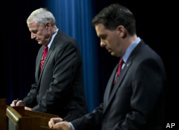 Wisconsin Gov. Scott Walker, right, and Democratic challenger Tom Barrett prepare to participate in a televised debate on May 25, 2012, in Milwaukee.