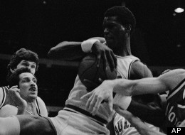 Orlando Woolridge (center) battles for a rebound during NBA action, February 24, 1982 in Chicago.