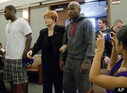 Floyd Mayweather Jr., right, walks into court escorted by his attorney Karen Winckler, center, and 50 Cent, left, to begin his 90-day jail term, Friday, June 1, 2012, in Las Vegas.