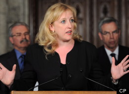 Minister of Labour Lisa Raitt speaks during a press conference in the Foyer of the House of Commons on Parliament Hill in Ottawa on Monday, May 28, 2012. (CP/Sean Kilpatrick)