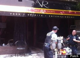 Police investigate the remains of Velvet Rope Ultra Lounge, a popular gay bar in Oak Park, Ill.