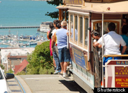 Cable cars take San Francisco tourists up and down the city's steep streets.