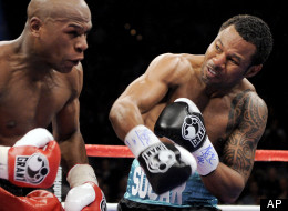 Shane Mosley connects with a right against Floyd Mayweather Jr. during the second round of their WBA welterweight boxing match Saturday, May 1, 2010, in Las Vegas. (AP Photo/Mark J. Terrill)