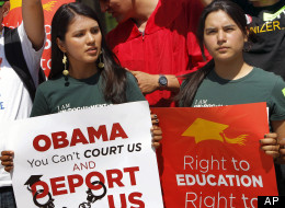 Students Maria Sofia, left, and Malendez Campos, protest at a