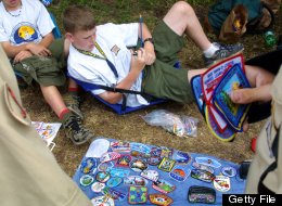 Boy scouts trade patches July 31, 2001 during the 15th National Scout Jamboree at Fort A.P. Hill, Va. (Photo by Alex Wong/Getty Images)
