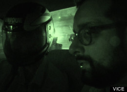 Suroosh Alvi, a founder of VICE, interviews an assassin in the back of a car in Karachi, Pakistan, war on terror
