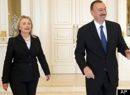 Azeri President Ilham Aliyev, right, and U.S. Secretary of State Hillary Clinton walk to meetings at the presidential Zagulba residence in Baku, Azerbaijan on June 6, 2012.