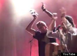 Dirk Nowitzki holds up a tambourine during his performance with the Avett Brothers.
