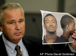 Auburn Police Chief Tommy Dawson holds up a photo of Desmonte Leonard, 22, of Montgomery, Ala., the suspect wanted for fatally shooting three people, including two former Auburn University football players, and wounding another three people during a party at an apartment complex near the school, at a news conference Sunday, June 10, 2012, in Auburn, Ala.