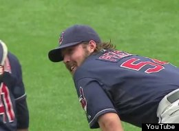 Indians' pitcher Chris Perez laughs with catcher Carlos Santana after vomiting during a 4-1 win over the Cardinals.