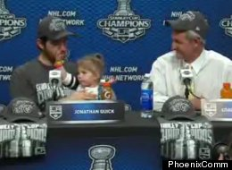 Kings' goaltender Jonathan Quick sits with his daughter Madison alongside coach Darryl Sutter shortly after the Kings' Stanley Cup victory in Game 6 of the Stanley Cup Finals.