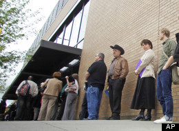 In this April 24, 2012, photo shows job seekers waiting in line during a job fair, In Portland, Ore.