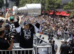 The LA Kings parade down Figueroa Street in downtown Los Angeles (Associated Press)